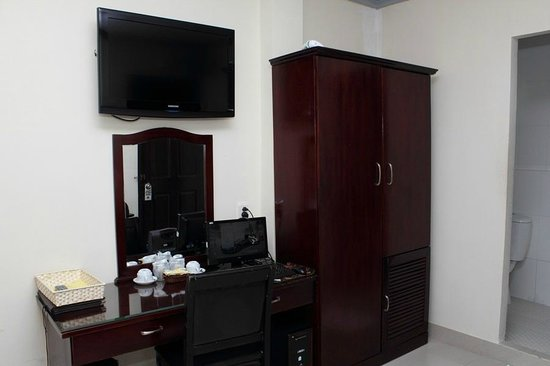 Beautiful Saigon Hotel 2: TV, desktop PC & cupboard