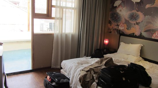 Shanghai Fish Inn Bund: Guess I should have taken the pic with the bed made- sorry!