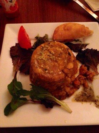 Vejigante: Mofongo stuffed w/ pepper tofu in creole sauce (a stray Arepa on side)