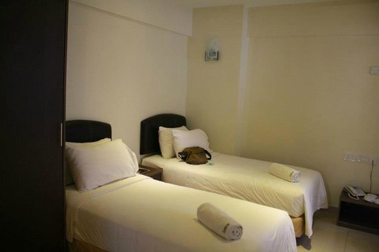 Sunbow Hotel Residency: Room with 3 single beds