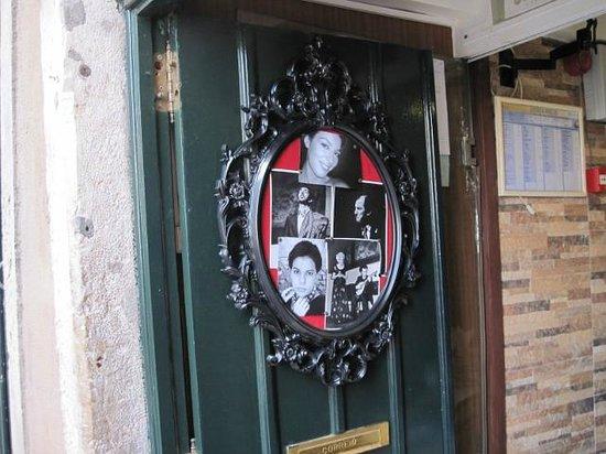 """Restaurante Esquina de Alfama : Esquina de Alfama, photos of """"fadistas"""" on the door"""
