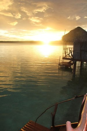 Aitutaki Lagoon Resort & Spa: Sunset from the overwater bungalow