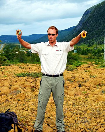 The Old World In His Hands. Park Interpreter Cedric at The Tablelands, Gros Morne National Park,