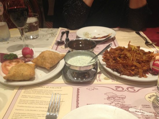 Koh-i-Noor: Samosas on the left and fried onions on the right.