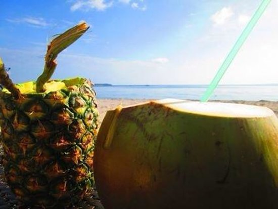 Anika Island Resort: pineapple and buko juice sold at the beachfront:)