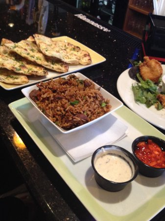 Ambrosia Tavern : Lamb biryani with yummy yogurt sauce! Garlic cilantro naan and coconut shrimp with spicy curry s