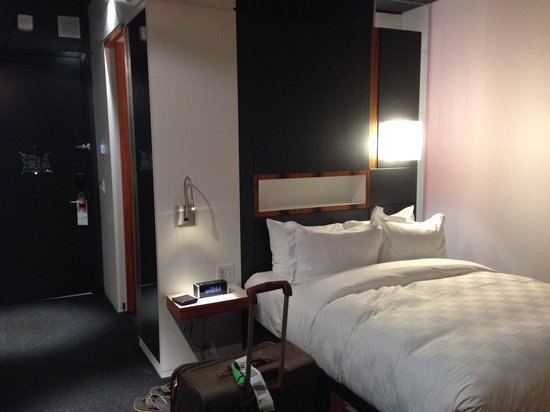 ALT Hotel Halifax Airport : Comfy bed, convenient bedside table with proper outlets... what a concept!