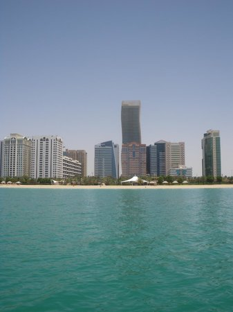 La Corniche: From the Water: A view of Abu Dhabi's Corniche with the city.