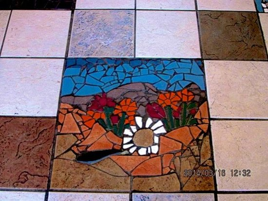 Bean Trees Cafe: Handmade mosiac artwork is featured in the tile floor.