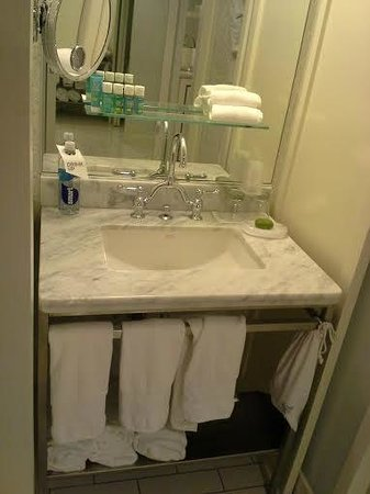 Sink Between Bedroom Table And Toiletshower Partition Picture Of - Bathroom partitions atlanta ga