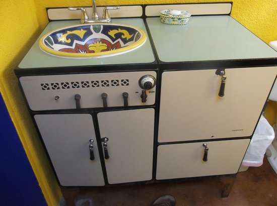 Pelican Spa: I love how the bathroom sink is an old stove!  such a cute idea!