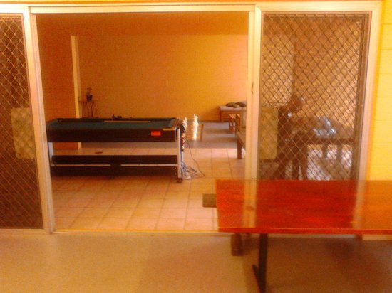 Civic Guest House Backpackers Hostel: free pool table and games room, plus beautiful timber tables everywhere!