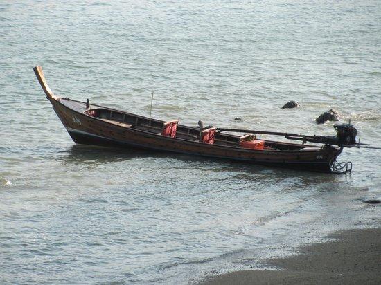 Amari Phuket: a long tail traditional long-tail thai boat just below our room verandah