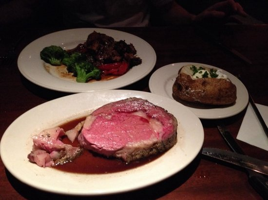 Stonewood Grill & Tavern : Prime rib and boneless short ribs. Baked potato on the side.