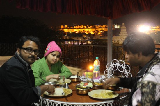 Enjoying the diner at Roof-top restaurant of Hotel Akashdeep