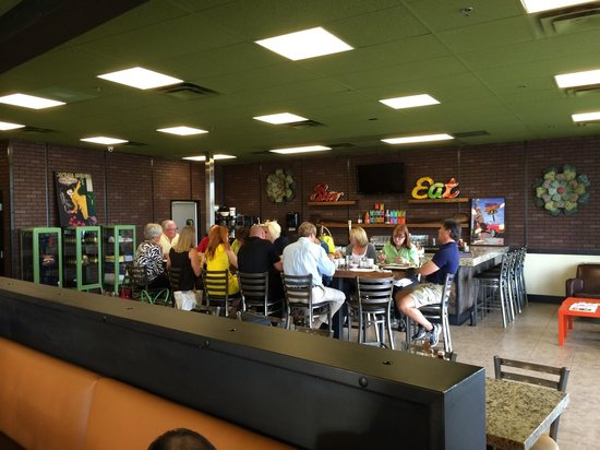 Perk Eatery: Dining area for groups. Notice the autographed poster of Guy on the wall.