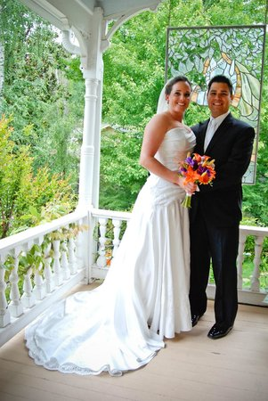 The Seasons Bed and Breakfast: Bride & Groom on picturesqe porch