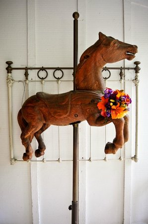 The Seasons Bed and Breakfast: Carousel Horse on Porch