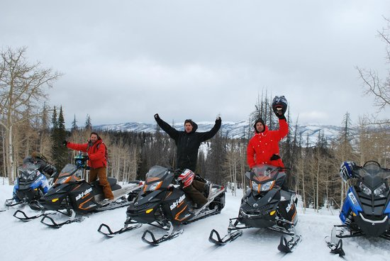 Utah Mountain Resort Tours - Day Tours : Guest out Snowmobiling in the Uintas