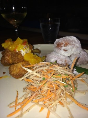 Ka'ana Kitchen: Chicken accompanied by Asian slaw and mansada, a type of