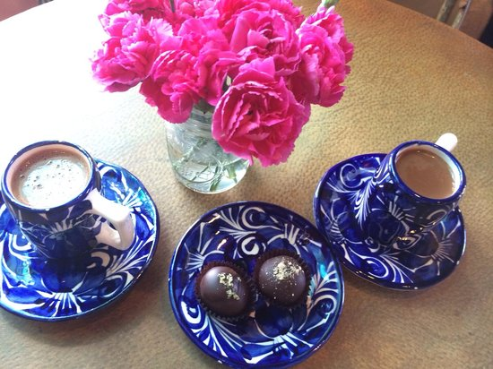 Kakawa Chocolate House: From L to R: Marie Antoinette, goat cheese and peanut butter truffles, and Tzol drinking chocola