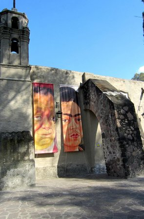 Museo Dolores Olmedo Patino: Diego Rivera and Friday Kahlo posters on an external gallery wall