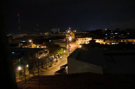 Hotel Cacts: View of city at night from the patio