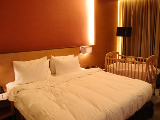 The T Hotel: The king size bed with baby bed