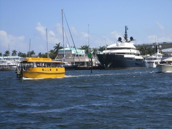 Water Taxi with Mega Yacht in background