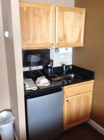 Legacy Vacation Resorts-Steamboat Hilltop : Kitchenette in studio. Contains dish washing liquid, silverware, plates/cups, can opener, coffee