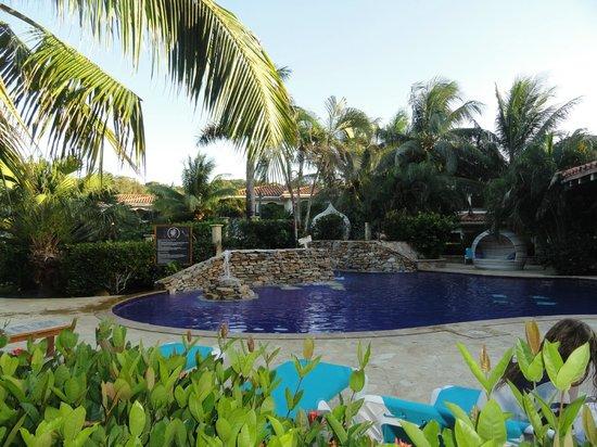 "Mayan Princess Beach & Dive Resort : Beautiful pool with ""tear drop"" lounging. Very relaxing."