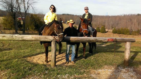 Double J stables & Campgrounds: Riding Larry and Duke with owner, Dave, in the center.