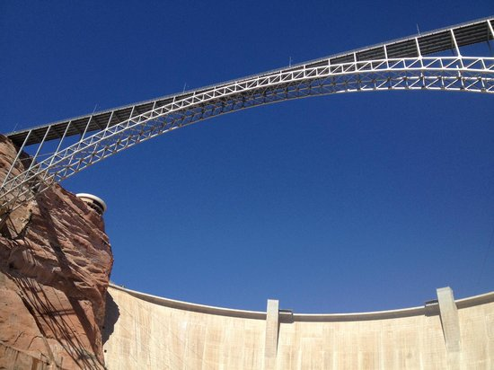 Colorado River Discovery : View of Glen Canyon Dam and Bridge from the River