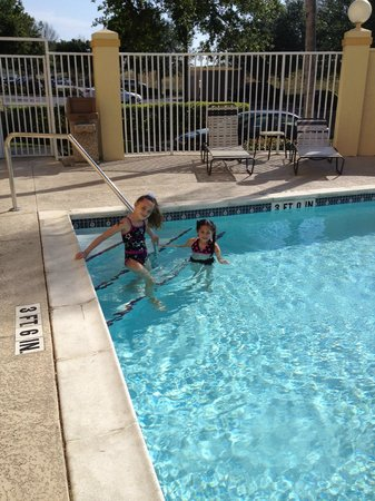 La Quinta Inn & Suites Orlando UCF: The girls enjoying the pool at La Quinta Inn Hotel in Orlando
