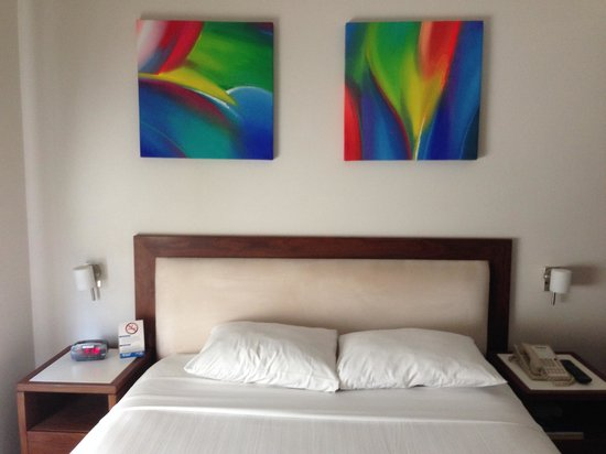 Hotel HEX: Fresh, modern feel to the room with art over the headboard