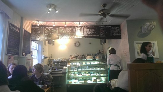 Treats Tea Room: Service area of Treats, with prices and baked goodies