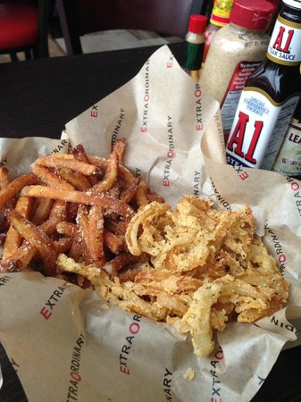 EO Burgers: Side of parm fries and onion rings