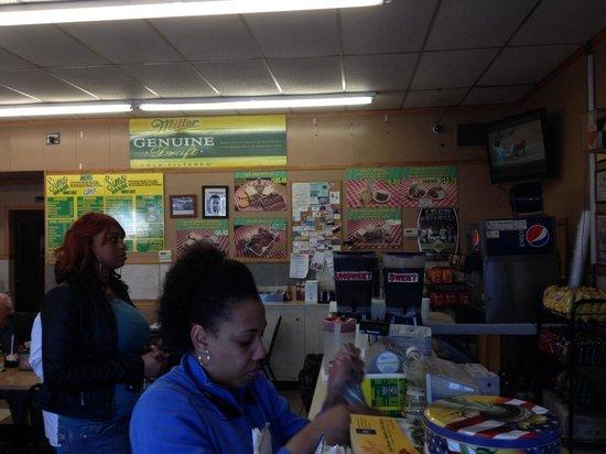 Sim's Bar-b-que: Customers checking out and checking menu!