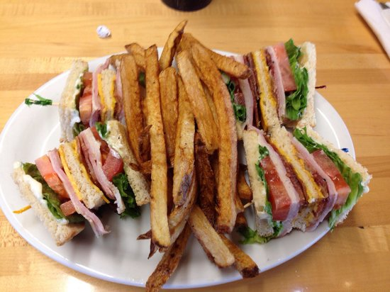 Oasis Truckport Restaurant: Club Sandwich with hand cut fries.