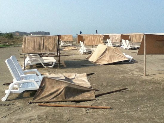 Occidental Cartagena : High winds blow over the shades on beach at Occidental, Cartagena, Colombia - beach almost deser