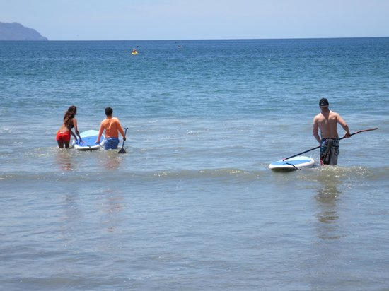 Pura Vida Ride: Reeni helping my younger son onto the SUP