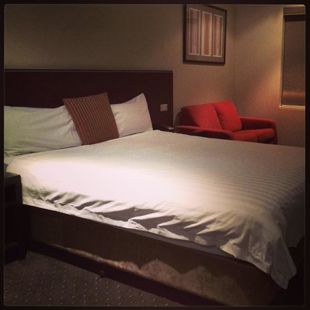 "Atlantis Hotel: ""Docklands view"" room. Simple queen bed, couch and basic desk. Flat screen (smallish) TV directl"