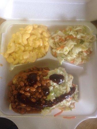 Smokey Pig Bar-B-Q : The shred dog is amazing. it's shredded pork on a hot dog bun with beans and mayonnaise slaw. Go