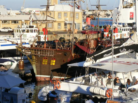 Waterfront Suites: There are many boats at the waterfront to add to your Cape Town experience.