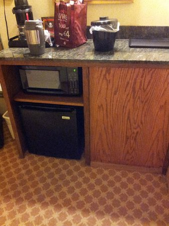 Country Inn & Suites by Radisson, Emporia, VA: Boarded up old fridge area and updated tiny mini-fridge.