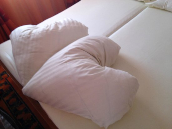 Hotel Cinderella: duvets on the bed when we arrived (bless!)