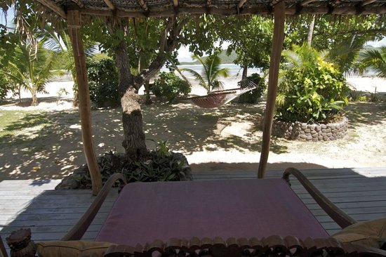Navutu Stars Fiji Hotel & Resort: view of private garden from daybed (beech visible in background)