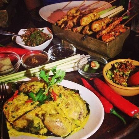 Bumbu Bali: A tray of mixed sates with rice cakes, peanut sauce and soya sauce, vegetables, pickles plus a r