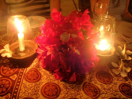 Flame Tree Cottages Restaurant : Candles on table
