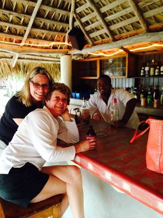 """Coral Cove Resort: The Hut Bar and """"Yeng"""" our bartender on the beach"""